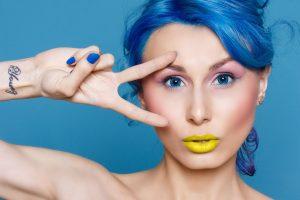 Blue hair highlights on woman