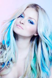 Closeup of a model with colorful hair-extensions.