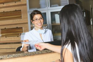 A dental assistance receptionist appointment at the dentist office